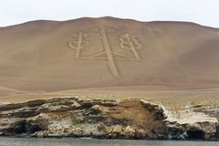 Candelabrum figure in Paracas national park, Peru. Ancient large-scale geoglyph Candelabrum figure in Paracas national park. It is a designated UNESCO World Stock Images