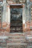 Ancient laterite door in temple Stock Image