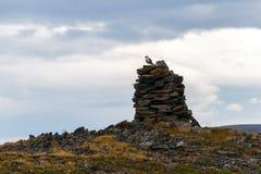 Ancient leading beacon on the bank of Novaya Zemlya Royalty Free Stock Photo