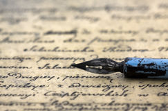 Ancient letter and pen. Ancient letter and old blue pen Royalty Free Stock Images