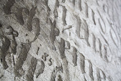 Ancient lettering background. Background or texture Stock Photos
