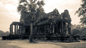 Ancient Library of Angkor Wat. Two ancient identical structures sit on either side of the path that leads to Angkor Wat, Cambodia. The buildings are believed to Royalty Free Stock Image