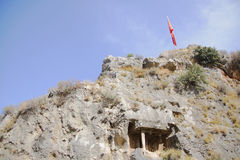 Ancient Licia tomb cut down in rock. Fethiye, Turkey Stock Photos
