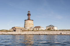 Ancient lighthouse on an island Royalty Free Stock Image