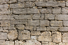 Ancient limestone wall Royalty Free Stock Photo