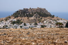 Ancient Lindos on Rhodes. Ancient town Lindos on Rhodes, Greece. View from the side of stone desert Stock Photography