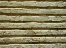 Ancient Lined Wall. Close up on cream background Royalty Free Stock Photos