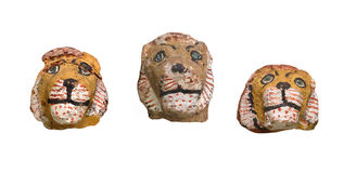 Ancient lion head figures isolated. Stock Photo