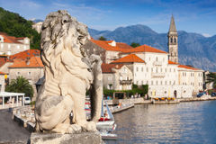 Ancient lion statue in Perast town. Ancient stone lion statue in Perast town, Bay of Kotor, Montenegro Royalty Free Stock Photo