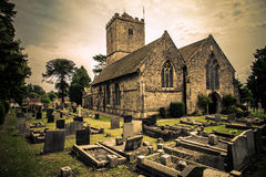 Ancient little church with graveyard Royalty Free Stock Images