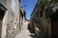 Ancient little street in typical French village Royalty Free Stock Image
