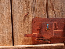 Ancient lock on wooden door. Very old wooden door with rusted lock and keyhole Royalty Free Stock Photo