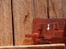 Ancient lock on wooden door. Very old wooden door with rusted lock and keyhole Stock Images