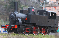 Ancient Locomotive. An ancient steam locomotive exposed in a city park Stock Image