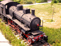 Ancient Locomotive. An ancient steam locomotive exposed in a city park Royalty Free Stock Photos