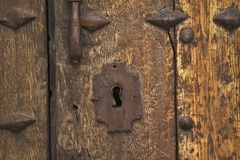Ancient Door Lock. This ancient look and the door have a vintage and antique look. The old mysterious door is a gateway to a forgotten dreams, visions and stock photos