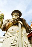Ancient lord stone statue in Thailand Stock Photography
