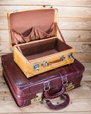 Ancient luggage on wood floor background is wood royalty free stock images