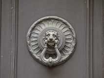 Ancient Luxury Door Knocker. On a brown door Stock Photography