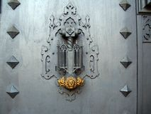 Ancient Luxury Door Knocker. On a grey door Stock Photography