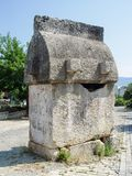 Ancient Lycian tomb in the street of the city of Fethiye. Turkey Stock Image