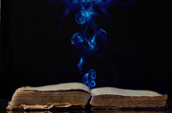 The ancient magic book. And magic flame escaping from it Royalty Free Stock Images