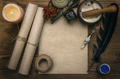 Witch doctor. Shaman. Witchcraft. Magic table. Alternative medicine. Ancient magic scroll paper sheet with copy space. Witchcraft. Witch doctor desk table Stock Photos