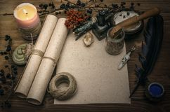 Witch doctor. Shaman. Witchcraft. Magic table. Alternative medicine. Ancient magic scroll paper sheet with copy space. Witchcraft. Witch doctor desk table Stock Images