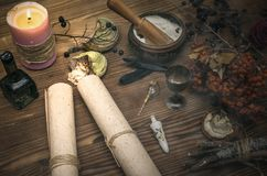 Witch doctor. Shaman. Witchcraft. Magic table. Alternative medicine. Ancient magic scroll on wooden desk table. Witchcraft. Witch doctor desk table. Magic Stock Images