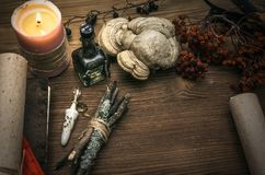 Witch doctor. Shaman. Witchcraft. Magic table. Alternative medicine. Ancient magic scroll on wooden desk table. Witchcraft. Witch doctor desk table. Magic royalty free stock images