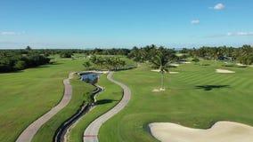 Flight over green golf field stock video