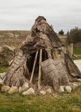 Ancient man hut. Teepee or wigwam tent house, outdoors. Prehistoric house from skins leather royalty free stock photos