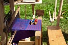 Ancient manual weaving loom machine Stock Image