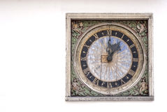 Ancient manufactural clock on a wall of a building... Royalty Free Stock Photography