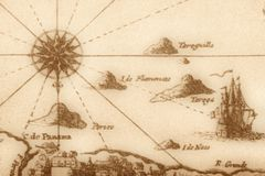Ancient map (fragment). Vintage map with islands, ship and compass Royalty Free Stock Photos