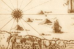 Ancient map (fragment). Vintage map with islands, ship and compass Stock Photography