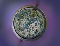 Ancient map globe. An old toy globe with symbolic ancient map. Blurred background royalty free stock images