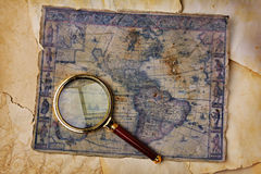 Ancient map and magnifying glass Royalty Free Stock Photo