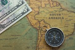 Ancient map of South America with usa money and a compass, close-up stock images