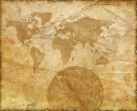 Ancient map of the world. Compass. Ancient map of the world. The torn, scorched edges. Compass Royalty Free Stock Image