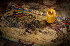 Ancient maps. Some old maps on the table and one old candle Royalty Free Stock Images
