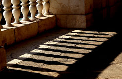 Ancient marble balustrade with pillars  and the shadow Royalty Free Stock Photography