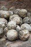 Ancient marble cannonballs in Castel Sant`Angelo in Rome Royalty Free Stock Photo