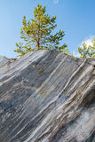 Ancient Marble quarry. Ancient Marble quarry, marble rocks in the wild in the Republic of Karelia. Natural stone. Ancient faults marble Imperial times. Slices Stock Photos