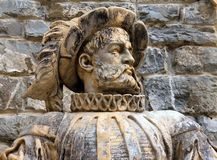 Ancient marble statue of a nobleman on a background of stone wall of Peles Castle in Sinaia, Prahova County,Romania stock photos