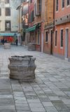 Ancient marble well in calle of Venice Stock Photo