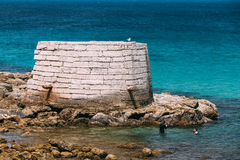 Ancient marine fortifications. Ruins of old tower Stock Images