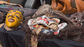 Ancient masks in a garage sale royalty free stock images