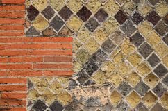 Ancient masonry renewed with modern brickwall Stock Photo