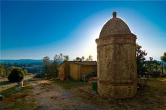 Ancient masonry well in the Tuscan countryside. Sun rises behind the historic octagonal masonry well in the Tuscan countryside Stock Photo